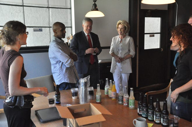 Buchi executives Jeannine Buscher, Zane Adams and Sarah Schomber speak with Congressman Mark Meadows and his wife Debbie as they offer samples of their beverage lineup.