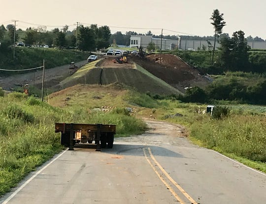 The North Carolina DOT is putting a new bridge in and leveling out the slope of Fanning Fields Road in the Broadpointe Industrial Park in Mills River.