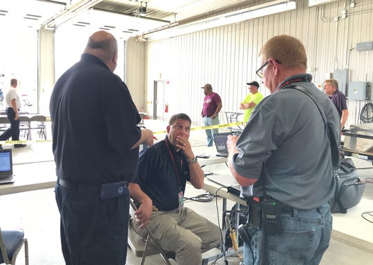 Officials at the command center for emergency responders at the scene of Conklin flooding.
