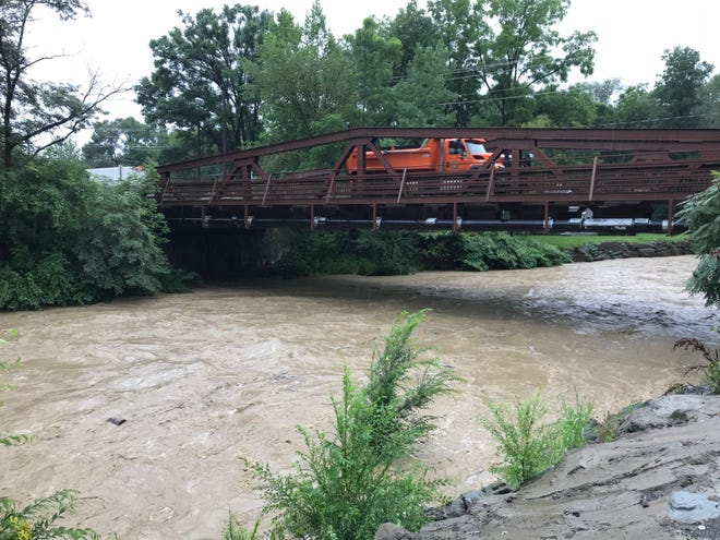 A flooded Choconut Creek in Vestal on Tuesday, Aug. 14, 2018.