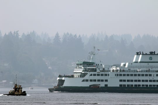 The Washington State Ferry Chimacum departs Bremerton as a smoky haze hangs over Sinclair Inlet on Tuesday.