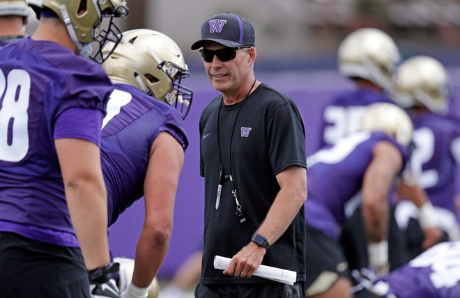 Chris Petersen isn't necessarily comfortable with the idea that his Washington Huskies are favored to win the Pac-12.