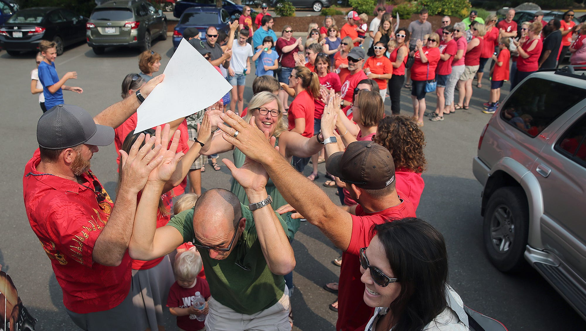 North Kitsap High School teachers Mike McCorkle, and Gayl Teneyck go through a gauntlet as they head to bargain at the WEA headquarters in Poulsbo on Monday August, 13, 2018. Teachers in CKSD and NKSD rally as districts negotiate salary increases resulting from the McCleary decision. Bainbridge, with a 21 percent increase, got one of the highest salary bumps in the state. South Kitsap has reached a tentative agreement and negotiations are wrapping up in CK and NK. Bremerton will wrap up by the end of the month.