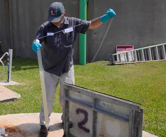 Eric Casavant with SGS Labs was out Tuesday taking water samples from sewage lift stations around Cocoa Beach and reuse water at different locations. He was taking two 125 milliliter bottles from each location.