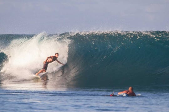 Brian Dery catches a wave on one of the surfing trips that inspired him to develop the Banana Bag Oral Solution. Now its helping people with chronic illness all over the nation.