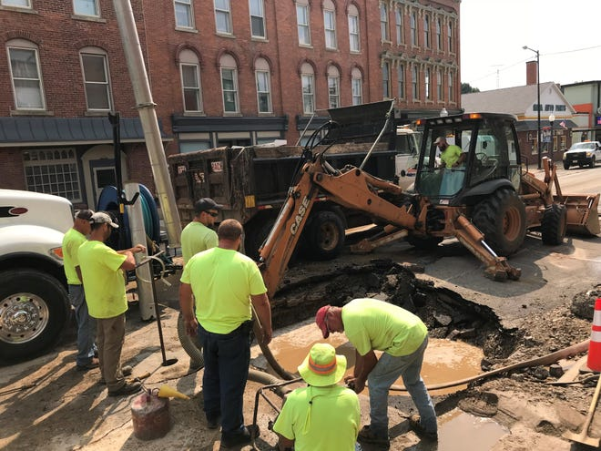 Galion employees work to repair a water main that burst Tuesday afternoon.