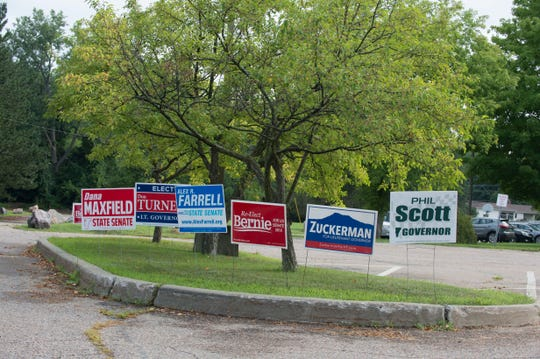 Campaign signs primary candidates dot the grounds of Orchard School, one of the polling stations in South Burlington on Tuesday, August 14, 2018.