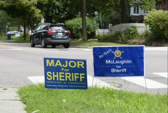A campaign sign for Michael Major, a Chittenden County deputy sheriff, sits along side one for his boss, Sheriff Kevin McLaughlin, the man Major is trying to replace.