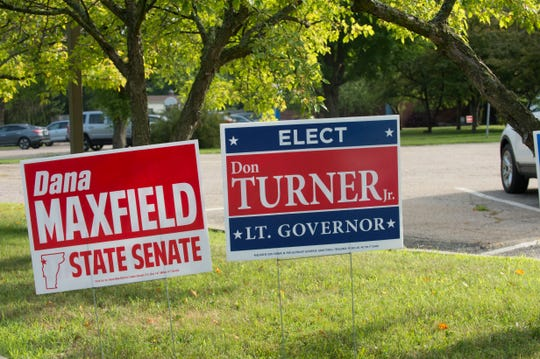 Signs supporting Dana maxfield, a candidate for Chittenden County state senator, and Don Turner, candidate for lieutenant governor, both Republicans, are seen on the grounds of Orchard School, a polling station in South Burlington, on Tuesday, August 14, 2018.