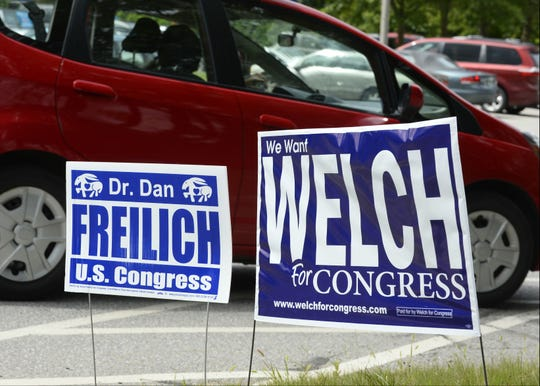 Campaign signs for Dan Freilich and Peter Welch, both candidates for the U.S. House, sand side-by-side in front of  Burlington Electric Department on Pine Street, one of Burlington's polling station, on Tuesday, August 14, 2018. Freilich is trying to unseat Welch in the Democratic primary.