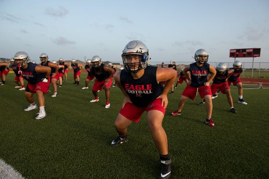 Veterans Memorial players run drills on the first day of practice for the 2018 season on Monday, Aug. 13, 2018.
