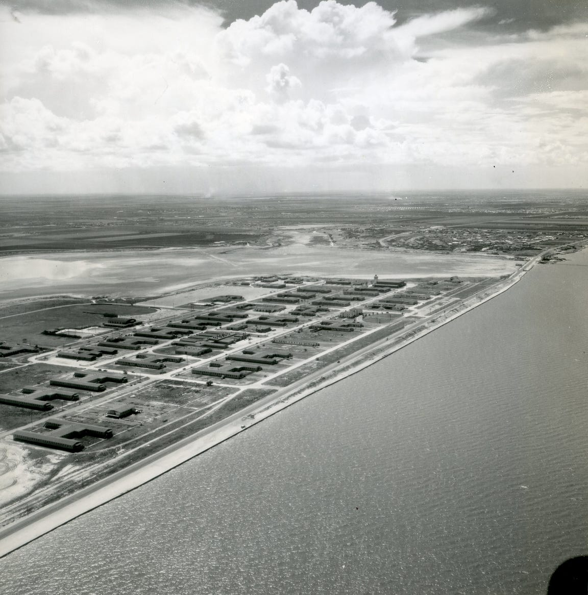 An aerial view of Ward Island on August 19, 1954 looking west toward Ocean Drive and Alameda Street.