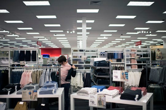 A customer tries on a shirt at the new, small-format Target in Westmont.