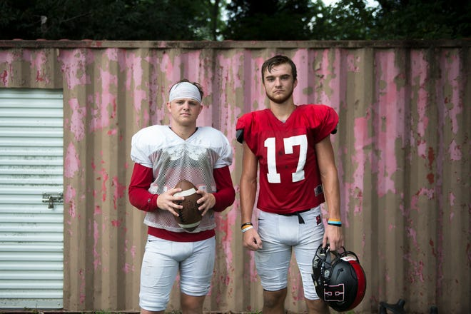 Haddonfield quarterback Jay Foley, left, poses with his brother and wide receiver Johnny Foley following practice Tuesday, Aug. 14, 2018 in Haddonfield, N.J.