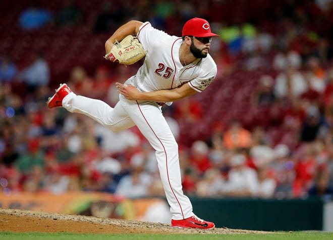 Cincinnati Reds starting pitcher Cody Reed (25) delivers a pitch in his his return appearance during the top of the eighth inning of the MLB interleague game between the Cincinnati Reds and the Cleveland Indians at Great American Ball Park in downtown Cincinnati on Monday, Aug. 13, 2018. The Reds lost to the Indians, 10-3.