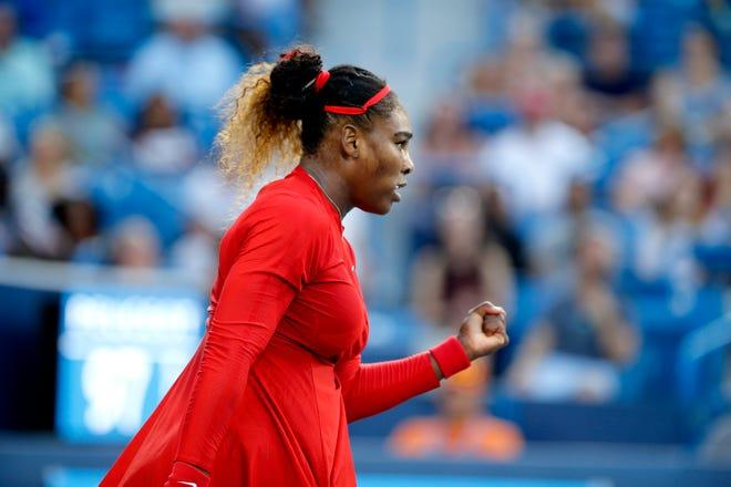 Serena Williams pumps her fist after winning a game over Daria Gavrilova.