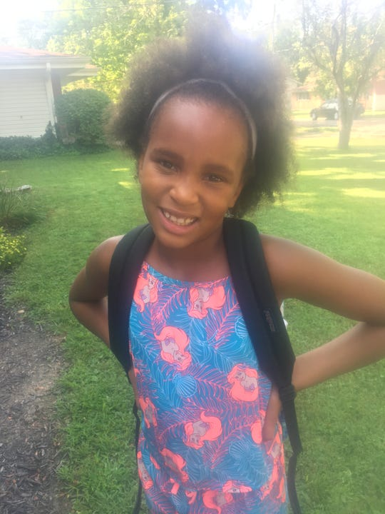 Tip: Clean your lens and you will take better photos. Oasis Ross, 7, of Forest Park looks blurry in this photo taken with a smudged lens.