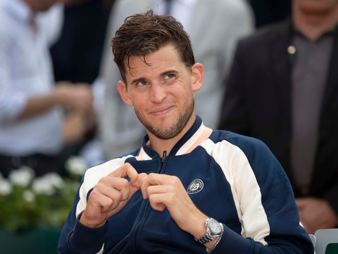 Dominic Thiem (AUT) as he waits for the trophy presentation to start after the mens' final on day 15 of the 2018 French Open at Roland Garros.