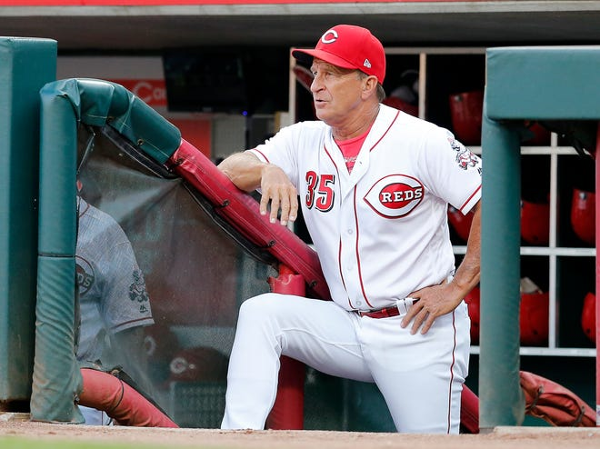 Cincinnati Reds interim manager Jim Riggleman (35) watched from the dugout in the first inning of the MLB interleague game between the Cincinnati Reds and the Cleveland Indians at Great American Ball Park in downtown Cincinnati on Monday, Aug. 13, 2018.