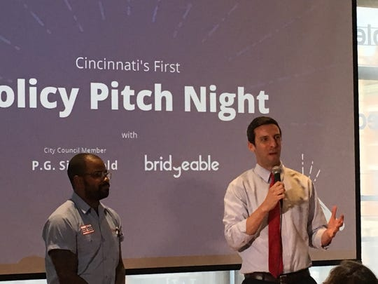 .P.G SIttenfeld with Policy Pitch Night Winner Derrick Braziel.