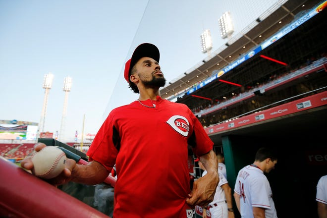 Cincinnati Reds center fielder Billy Hamilton (6) takes a look over the crowd, still in warmups on his off day, during the third inning of the MLB interleague game between the Cincinnati Reds and the Cleveland Indians at Great American Ball Park in downtown Cincinnati on Monday, Aug. 13, 2018.