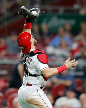 Cincinnati Reds catcher Tucker Barnhart (16) catches a pop up off the bat of Cleveland Indians first baseman Yonder Alonso (17) in the top of the seventh inning of the MLB interleague game between the Cincinnati Reds and the Cleveland Indians at Great American Ball Park in downtown Cincinnati on Monday, Aug. 13, 2018. The Reds lost to the Indians, 10-3.