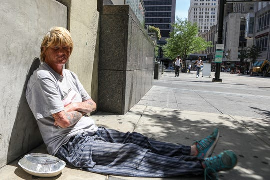 A homeless woman named Cindy sits outside at Fountain Square. A passerby gave her some Chipotle.