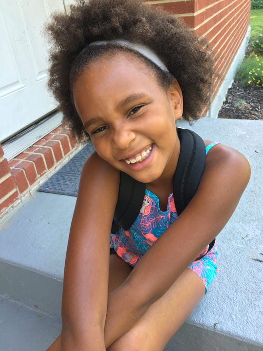 Tip: Clean your camera lens and get close to take good photos of your kids. Oasis Ross, 7, of Forest Park is ready for third grade.