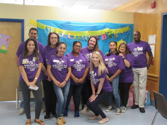 Catholic Charities, Diocese of Metuchen Staff Members and Volunteers gather for the Mobile Family Success Center (MFSC) of Middlesex County's first ever Community Baby Shower.
