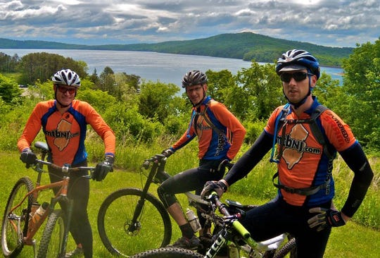 Scott Thomson and Kirt Mills of Somerset County and Jeremy Short of Hunterdon County enjoy the view at Round Valley Recreation Area in Lebanon.