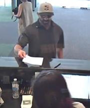Police said the man allegedly passed a note to the bank teller demanding cash.
