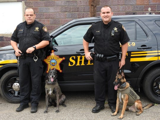 Det. Dave Stone with Henata and Dep. Steve Mox with Chili of the Coshocton County Sheriff's Office. The K-9 officers received new vests through a grant in 2018 they are seen wearing in this file photo. The units are a key part of fighting drugs in Coshocton County. Coshocton had the second highest number of drug cases in 2018 for the five county Central Ohio Drug Enforcement Task Force, behind Licking County.