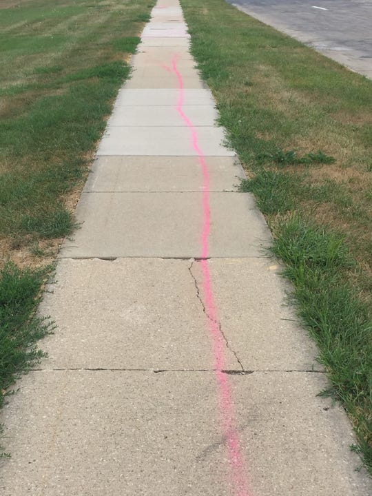 On Tuesday, Aug. 14, a jogger noticed the pink graffiti on the public sidewalk parallel to Ashworth Road, just south of the high school complex and track, said Sgt. Dan Wade with West Des Moines Police.