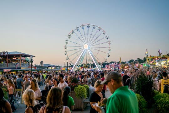 The streets of the fair filled with people during East Side Night on Friday, Aug. 10, at the 2018 Iowa State Fair.