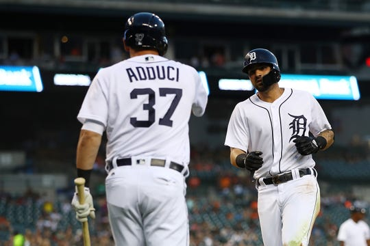 Tigers right fielder Nicholas Castellanos celebrates scoring a fourth inning run with first baseman  Jim Adduci on Monday, Aug. 13, 2018, at Comerica Park.