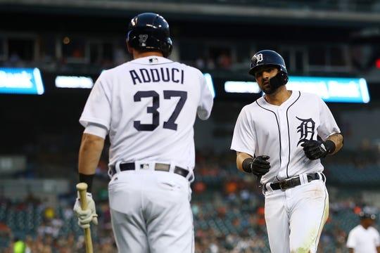 Tigers right fielder Nicholas Castellanos celebrates scoring a fourth inning run with first baseman  Jim Adduci on Monday, Aug. 13, 2018, at Comerica Park.