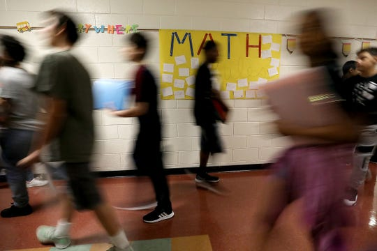 Students transition between classes at Wilkinson middle school in Madison Heights, Mich. on Thurs., Aug 9, 2018.