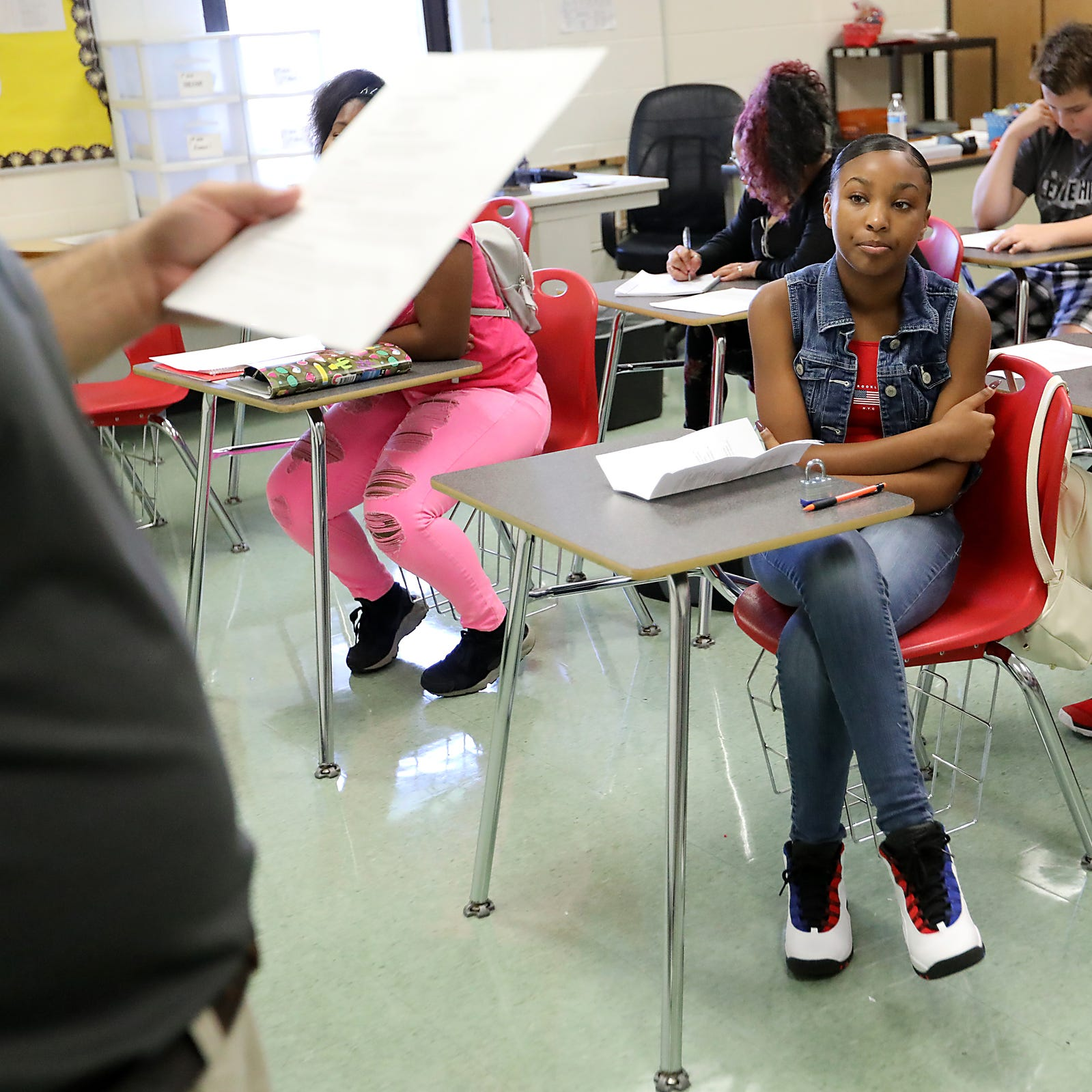 Tynae Ward, 13, of Harper Woods listens to instruction in her accelerated high school algebra class at Wilkinson middle school in Madison Heights, Mich., photographed on Thurs., Aug 9, 2018. Ward's school started early this year before Labor Day, cutting her summer short by almost a month.