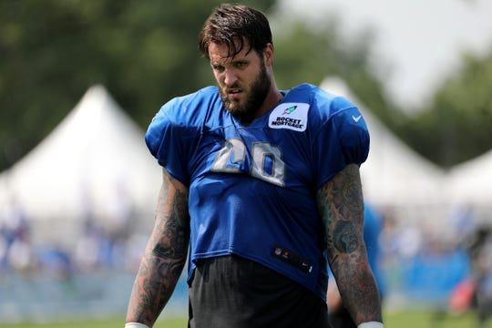 Lions offensive tackle Taylor Decker walks off the field after practice during training camp on Tuesday, Aug. 14, 2018, in Allen Park.