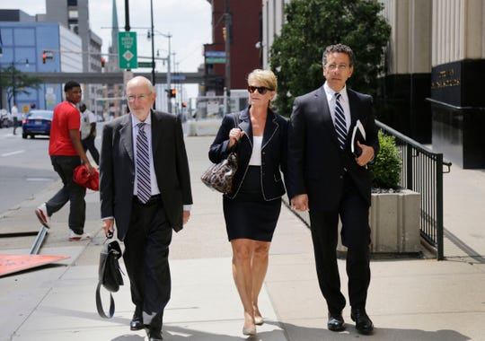 Al Iacobelli, former Fiat Chrysler labor chief, right and attorney David Dumouchel, left, walk out of the federal courthouse in Detroit on Tuesday, August 1, 2017.