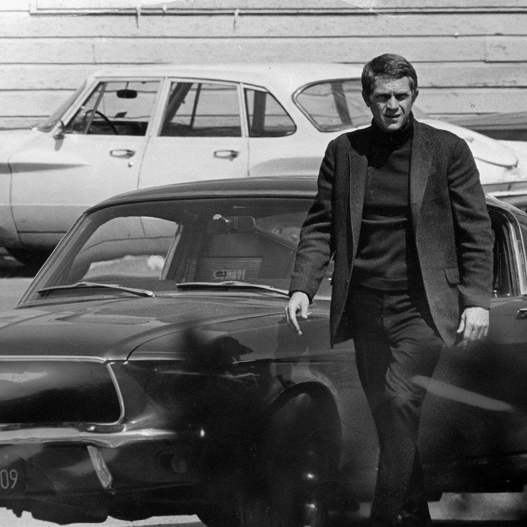 "Steve McQueen, starring in the title role of ""Bullitt,"" steps out of his car after a 140-mile-an-hour pursuit through the hilly streets of San Francisco.  The Technicolor action drama was filmed entirely on location in the Bay City."