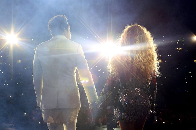 """Beyoncé and and Jay-Z perform on the """"On The Run II"""" tour at Ford Field on August 13, 2018 in Detroit."""