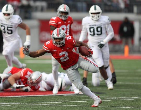 OSU running back J.K. Dobbins, now a sophomore, carves up the MSU defense last season.