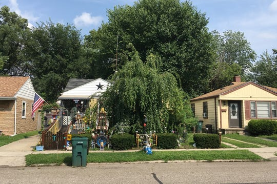 """Brian Tucker lives at the """"Tucker Ranch"""" on Almont Street in Ferndale, where a willow tree engulfs the yard with its branches and more knickknacks can be found the longer you look."""