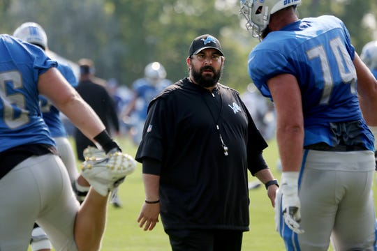 Detroit Lions coach Matt Patricia gives direction to offensive lineman Dan Skipper during practice on Tuesday, Aug. 14, 2018, in Allen Park.