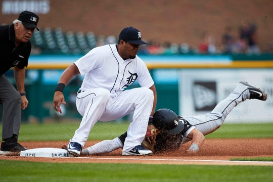 White Sox third baseman Yolmer Sanchez is tagged out by Tigers third baseman Jeimer Candelario trying to steal third in the first inning on Monday, Aug. 13, 2018, at Comerica Park.