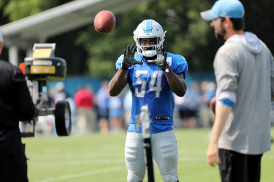 Lions linebacker Steve Longa catches passes at the end of practice during training camp on Tuesday, Aug. 14, 2018, in Allen Park.