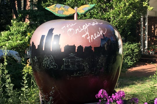 Florence Monnier and Fred Wood live at Ridge Road in Pleasant Ridge, also known as the house with the big apple. The apple was designed by their daughter-in-law, Cathy Sanders, and has been in the yard since around 2011 or 2012.
