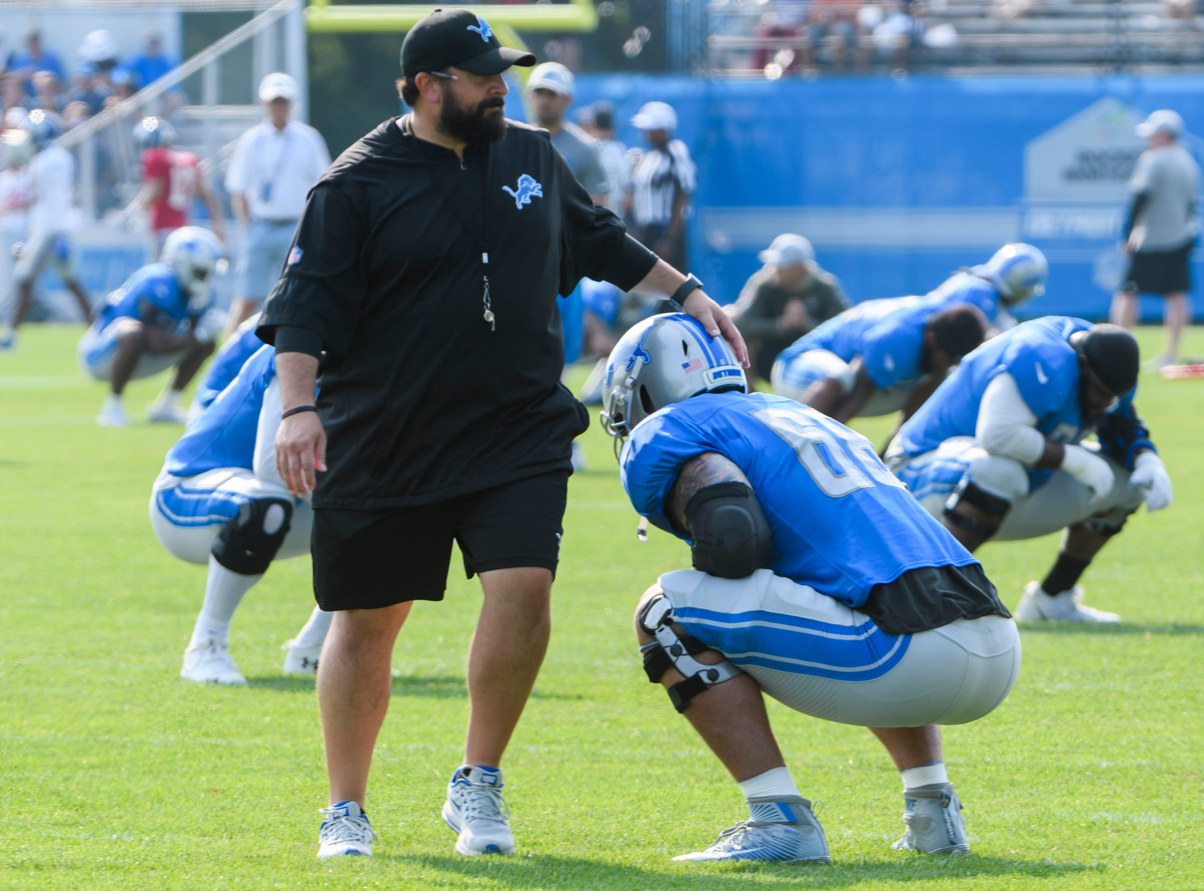 Lions head coach Matt Patricia says hello to tackle Taylor Decker during warmups.