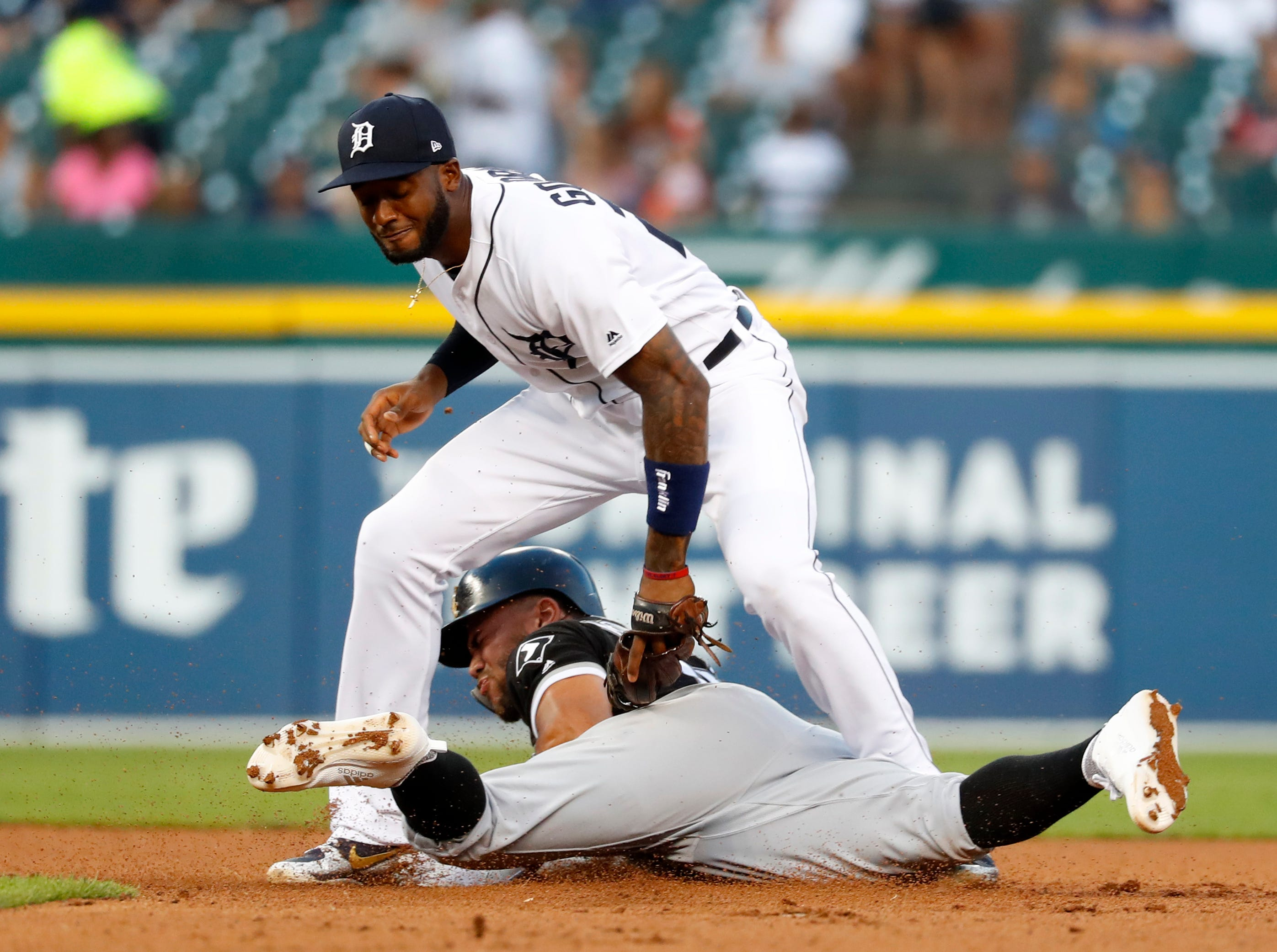 Detroit Tigers second baseman Niko Goodrum tags Chicago White Sox's Yoan Moncada out attempting to steal second base in the fourth inning.